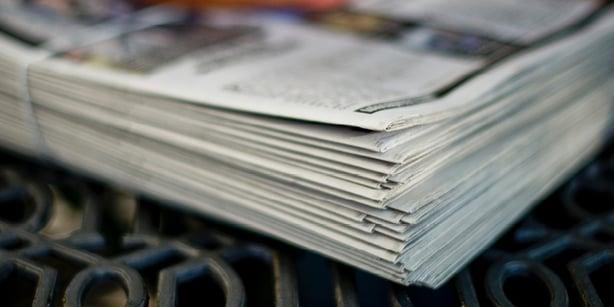 Newspaper stack tim-mossholder